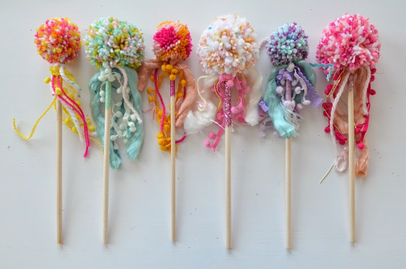 Look at these awesome rainbow pom pom wands