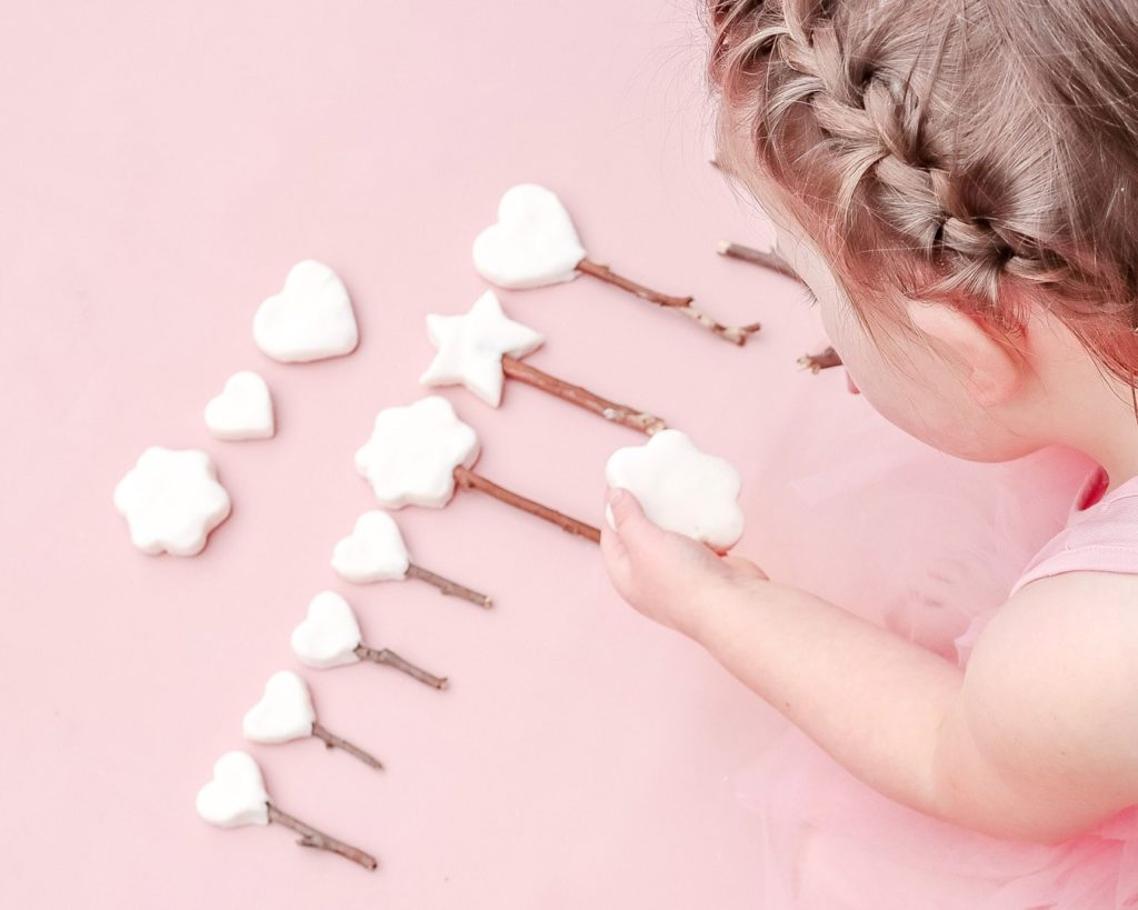 Adding sticks to the Sparkly Clay Fairy Wand Tutorial