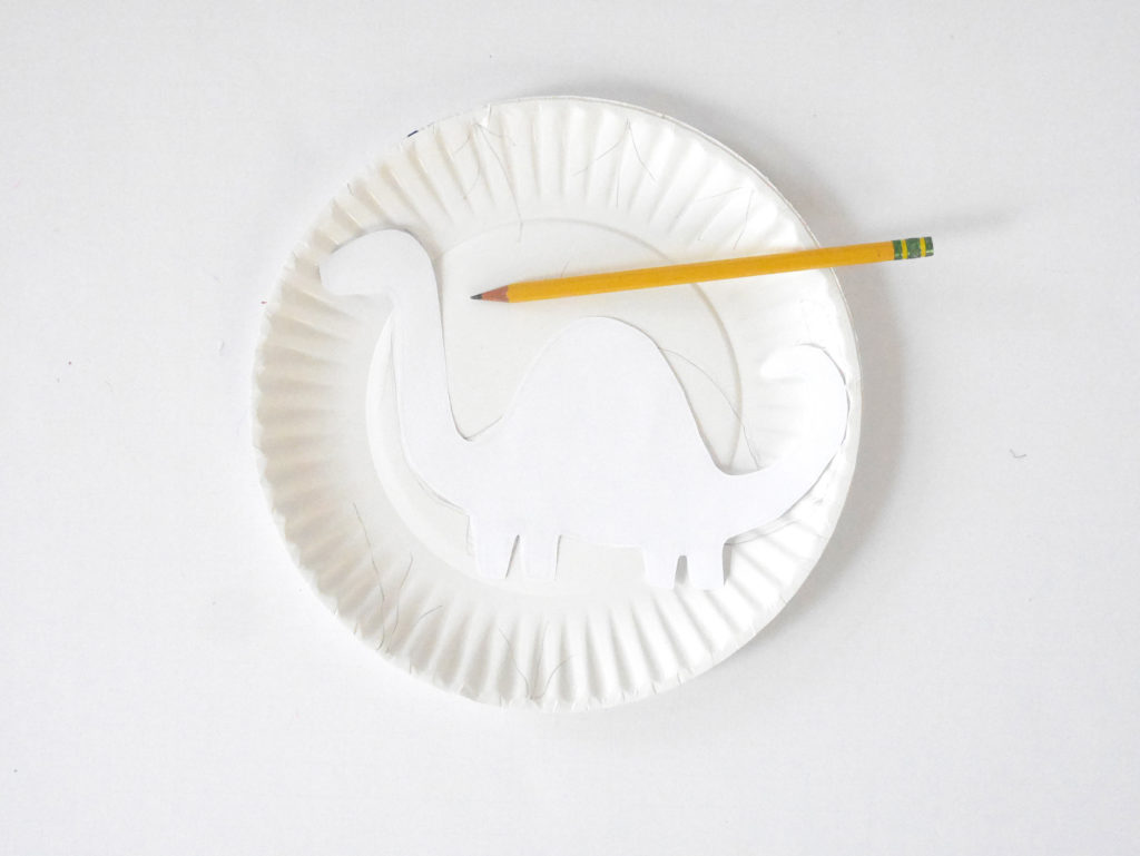 Step 2: Using your pencil trace the the Dino shape onto your plate.