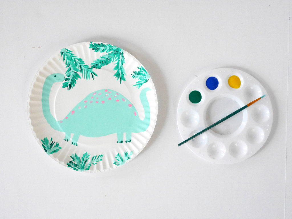 Step 3: Paint your dino in your favorite color (or colors!) and add some fun details like leaves, sky, clouds, scales and a BIG dino smile!